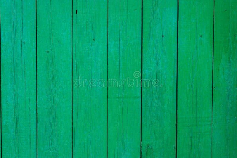 Le Fond Est Une Barrière En Bois Peinte Avec La Peinture Verte Image