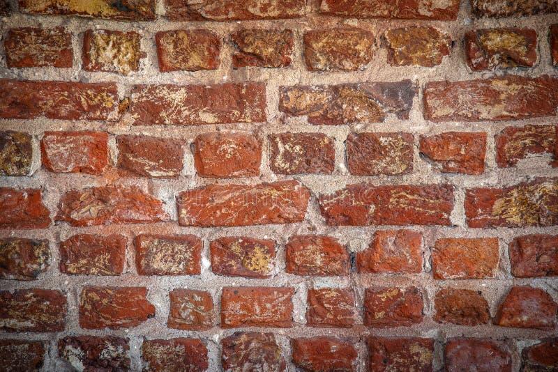 Le fond grunge de texture rouge de mur de briques avec les coins vignetted, peut employer ? la conception int?rieure photographie stock libre de droits