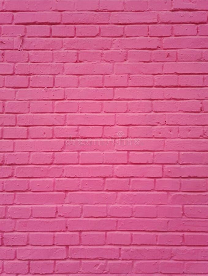 Le fond rose de mur de briques photos stock