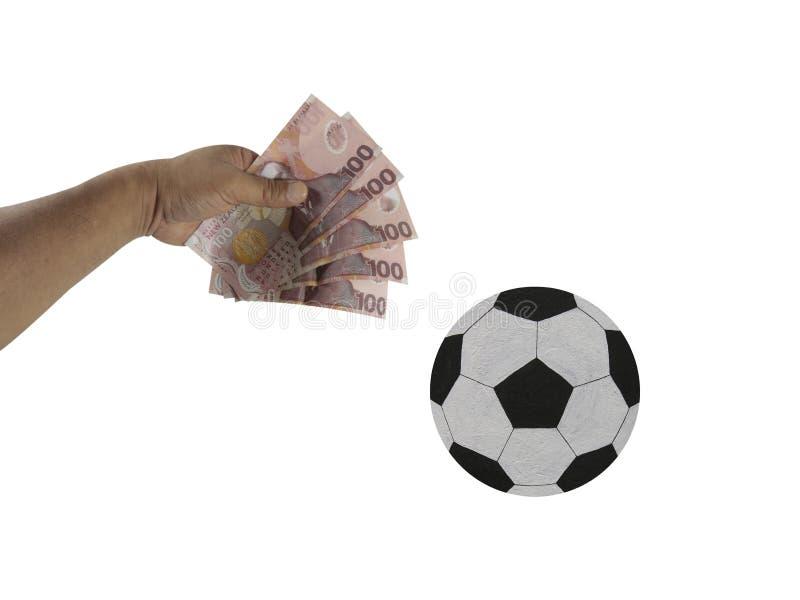 Le football, ballon de football, argent, main images libres de droits