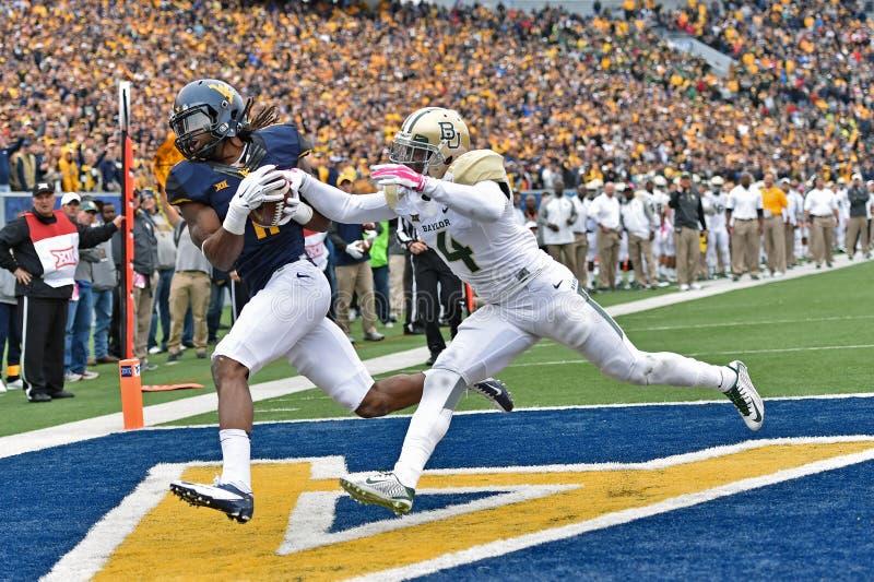 2014 le football d'université - crochet de touchdown photos stock