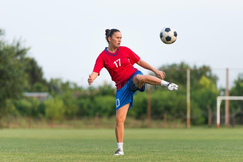 Le football femelle image libre de droits