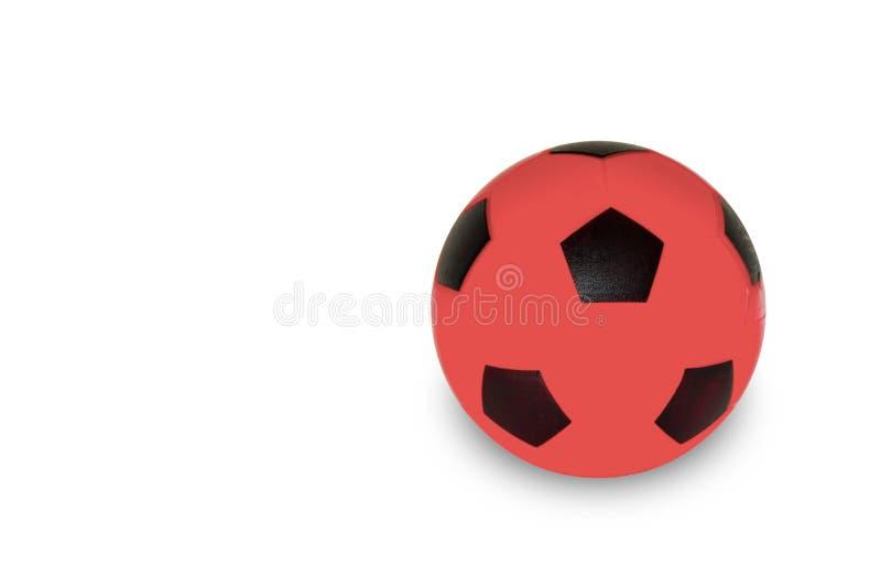 Le football rouge sur le fond blanc avec le chemin cliping photographie stock