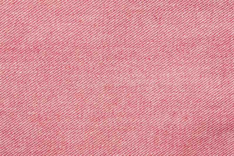 Le fragment rose de tissu de coton, macro a tiré la texture abstraite images libres de droits