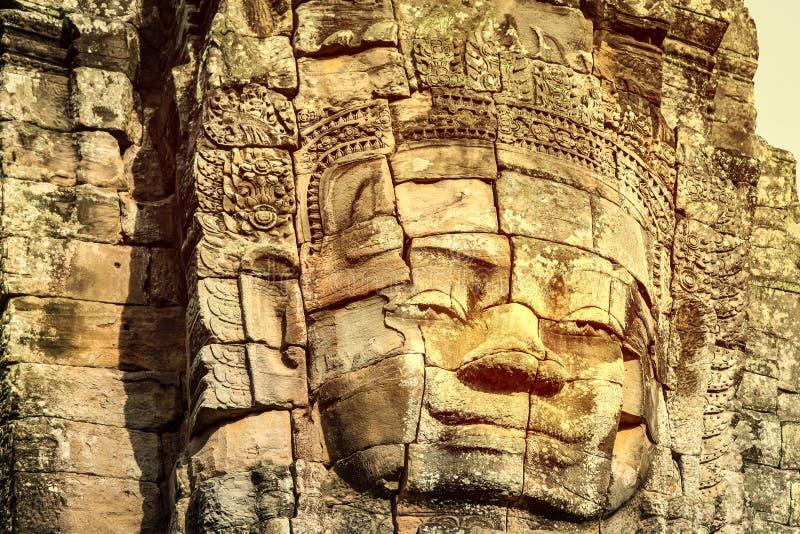 Le framsidor av den Bayon templet i Angkor Thom fotografering för bildbyråer
