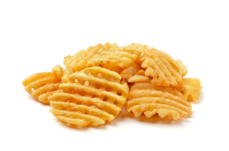 Le fritture croccanti delle cialde della patata, ondulate, il taglio della piega, criss attraversano i grida immagini stock libere da diritti