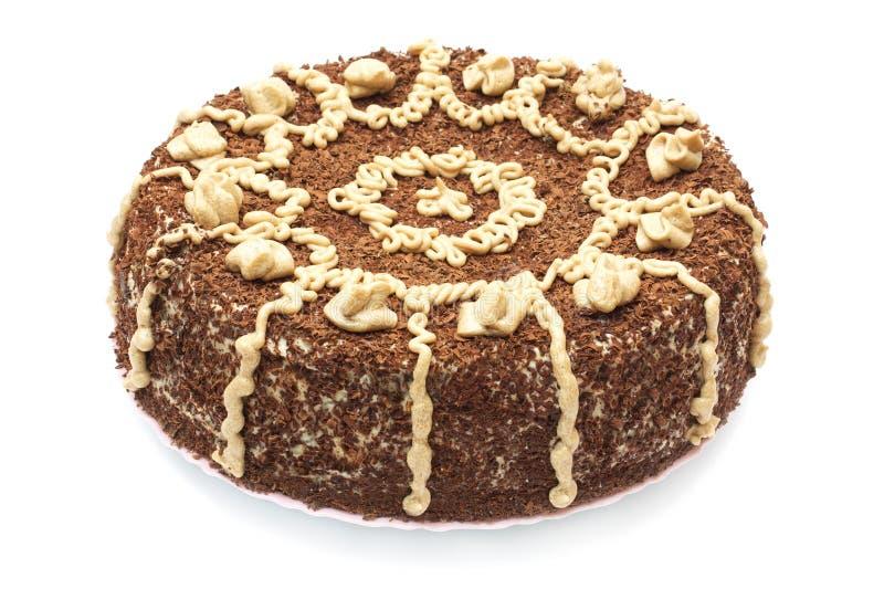 Le gâteau du chocolat et du pavot d'isolement sur le blanc image libre de droits