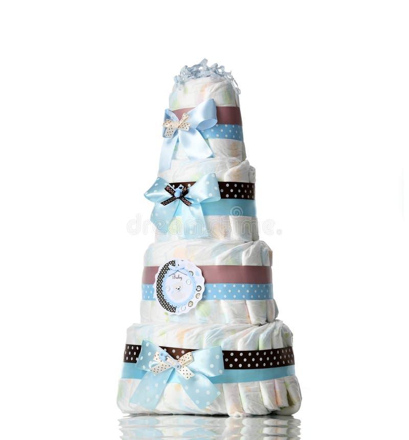 Le gâteau quatre de couches-culottes a nivelé le gâteau de couche-culotte avec les rubans bleus et les arcs pour le nourrisson de image stock