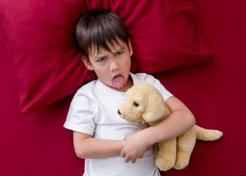 Le ` gagné vilain t de petit garçon vont dormir photos libres de droits