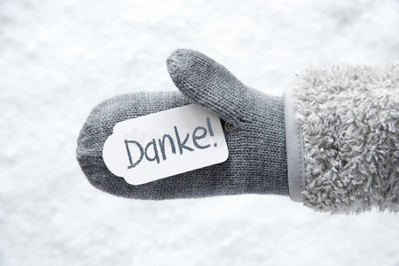 Le gant de laine, label, neige, moyens de Danke vous remercient image stock