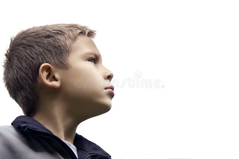 Le garçon beau examine solidement l'avenir photo stock