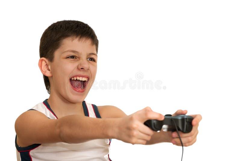 Le garçon d'ardeur joue un jeu avec le manche photographie stock libre de droits