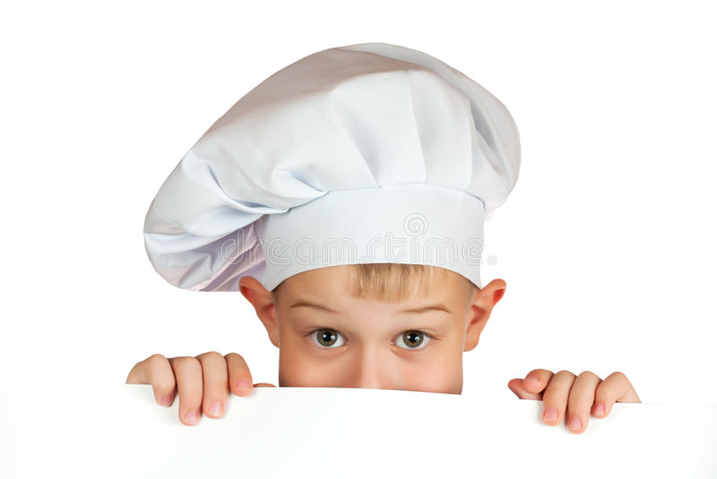 Le garçon de chef se cache derrière une feuille blanche images libres de droits