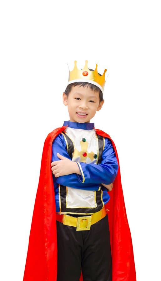 Le garçon est habillé dans le costume d'un prince photographie stock libre de droits