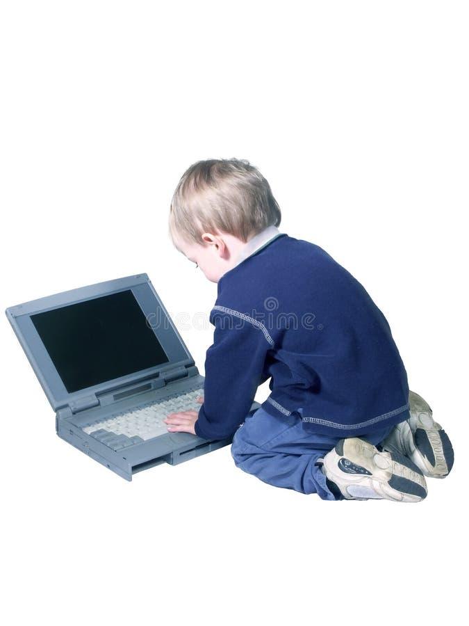 Le garçon et le computer#2. photos libres de droits