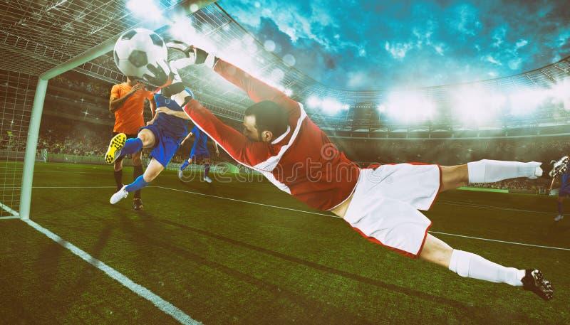 Le gardien de but attrape la boule dans le stade pendant une partie de football photo stock