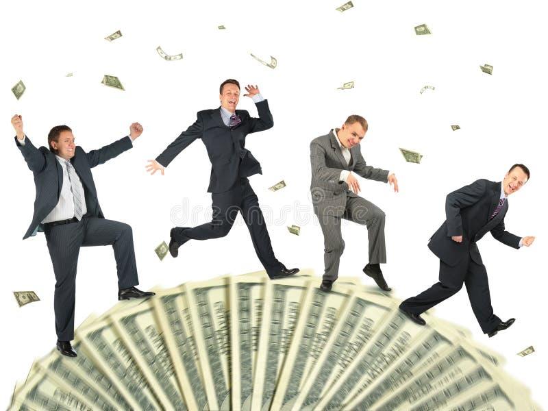 Le gens d'affaires courant sur le dollar roule le collage image libre de droits