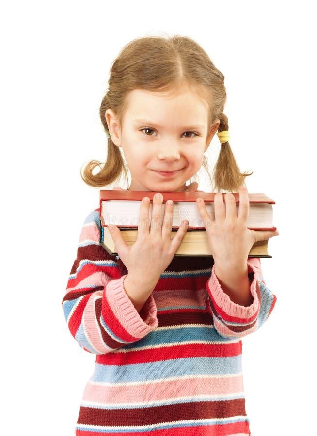 Le gentil enfant préscolaire retient des manuels photos stock