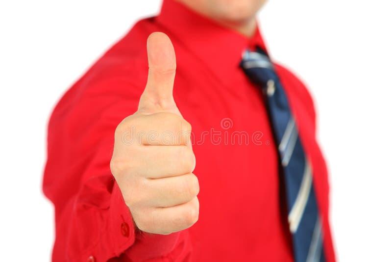 le geste d'homme d'affaires effectue la chemise rouge en bon état photo stock