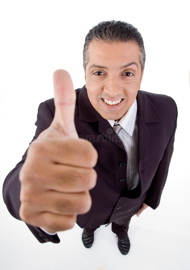 le gestionnaire affichant le pouce de sourire refont le plein de la vue images stock
