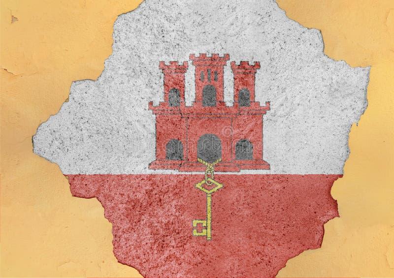 Le Gibraltar a fendu le trou et le drapeau cassé en grand matériel concret photos stock