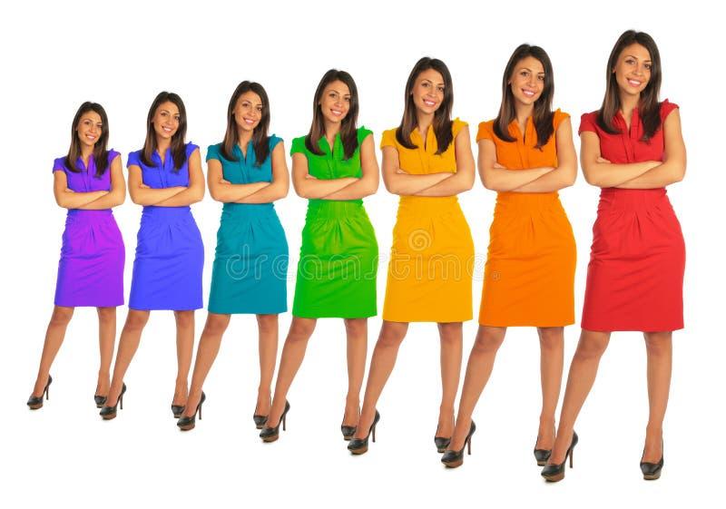Le giovani donne con colore del Rainbow vestono il collage fotografia stock libera da diritti