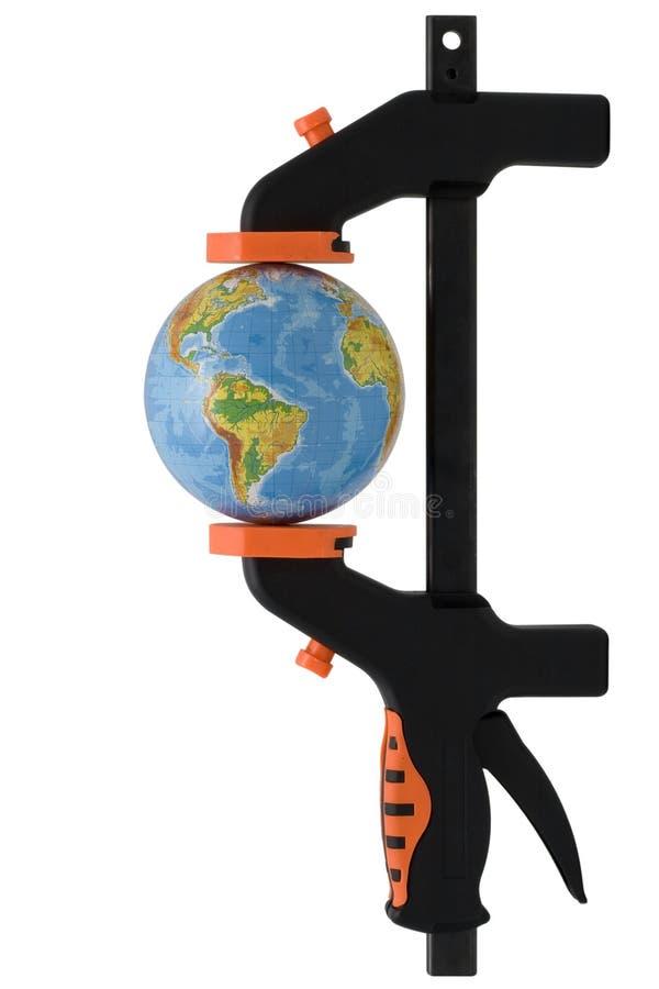 Le globe serré dans une bride manuelle image libre de droits