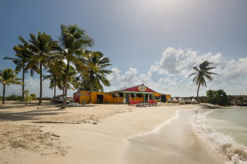 Lovely beach in Gosier, Guadeloupe. Le Gosier, Guadeloupe - December 20, 2016: View of rental shop building in a gorgeous sunny day in relaxing Lovely beach near stock photos