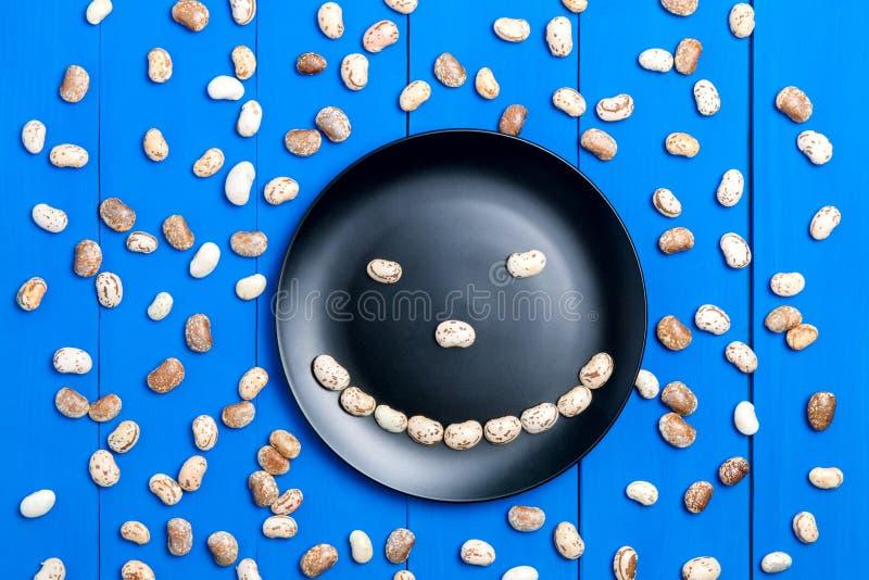 Le grand grain léger de haricot, cosse de haricot, beaucoup de haricots donnent au modèle une consistance rugueuse b images stock