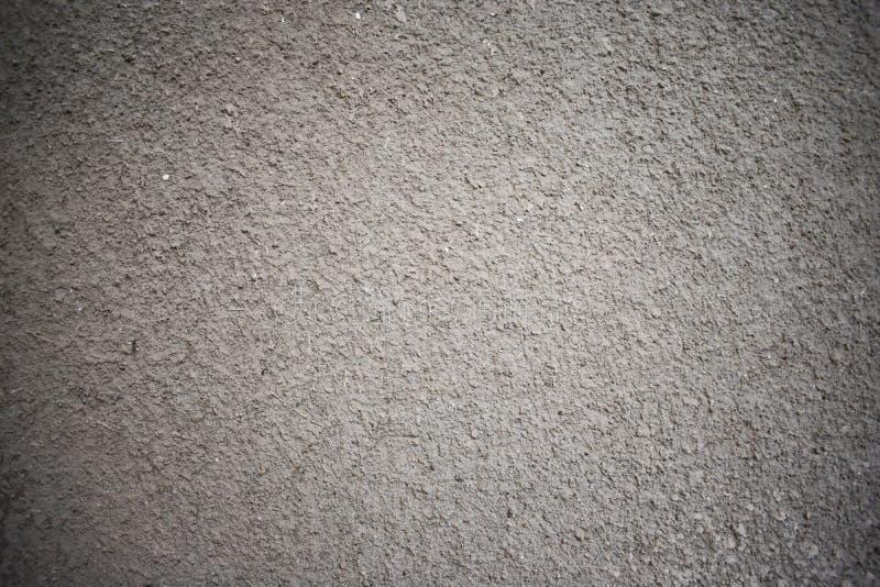 le gris a plâtré le fond plâtré foncé de mur photo stock