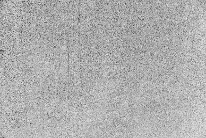 Le gris a plâtré le mur avec des traces de l'eau pour le fond photos libres de droits