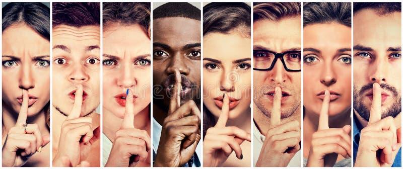 Le groupe de personnes femmes d'hommes avec le doigt sur des lèvres font des gestes photographie stock libre de droits