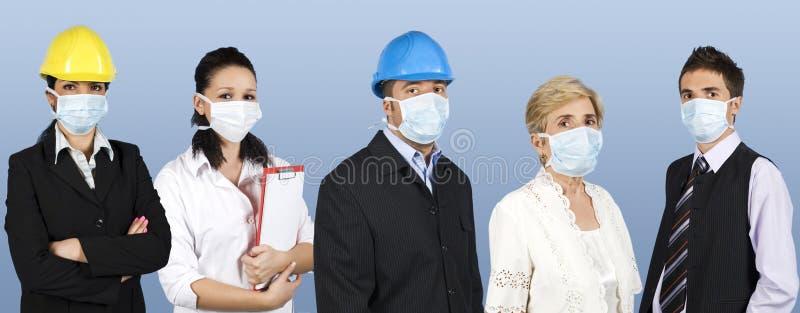 Le groupe de personnes se protègent contre la grippe photos libres de droits