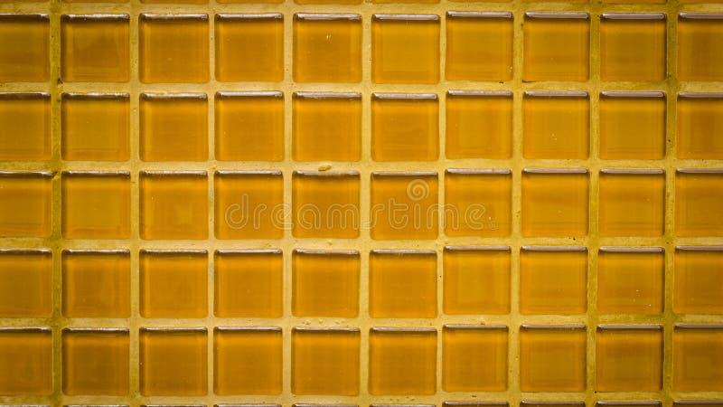 Le groupe de tuiles oranges donnent au fond une consistance rugueuse avec l'effet de vignette photo stock