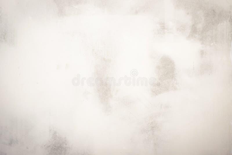 Le grunge donne à des milieux une consistance rugueuse Fond parfait avec l'espace Fond blanc de mur de stuc Texture peinte de mur photo stock