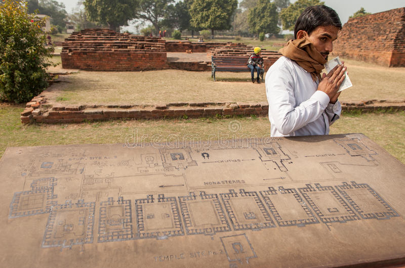 Le guide indien gardent son argent gagné image stock