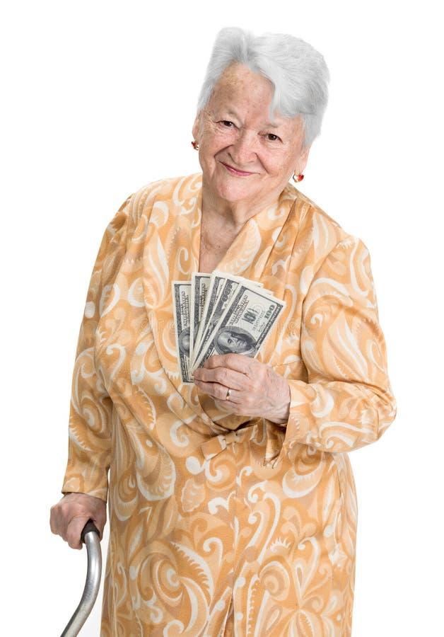 Le hållande pengar för gammal kvinna royaltyfri fotografi