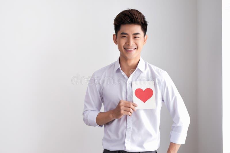 Le h?llande valentin` s f?r mannen card anseendet p? en vit bakgrund royaltyfri fotografi