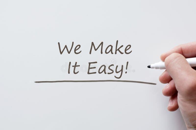 Le hacemos fácil escrito en whiteboard imagen de archivo libre de regalías