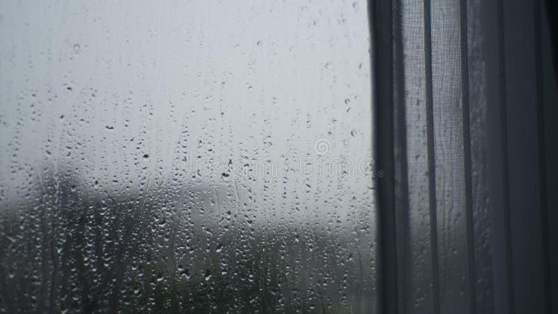 Le immagini di sfuocatura della goccia di pioggia sono bokeh fotografia stock