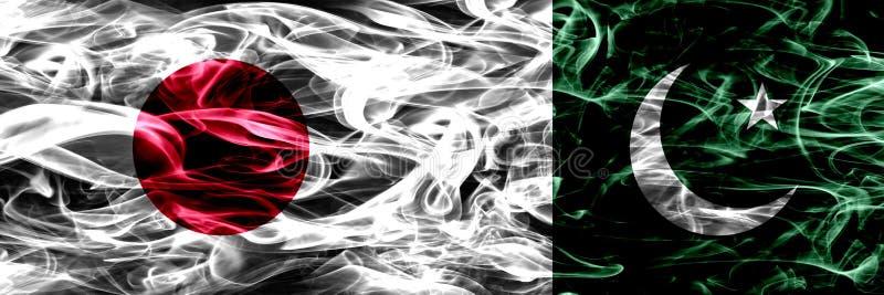 Le Japon contre le Pakistan, drapeaux pakistanais de fumée placés côte à côte illustration stock