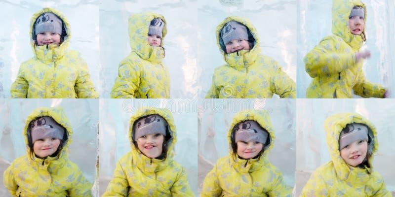 Le jaune heureux d'ijn de Giel pose derrière le morceau épais de glace photo stock