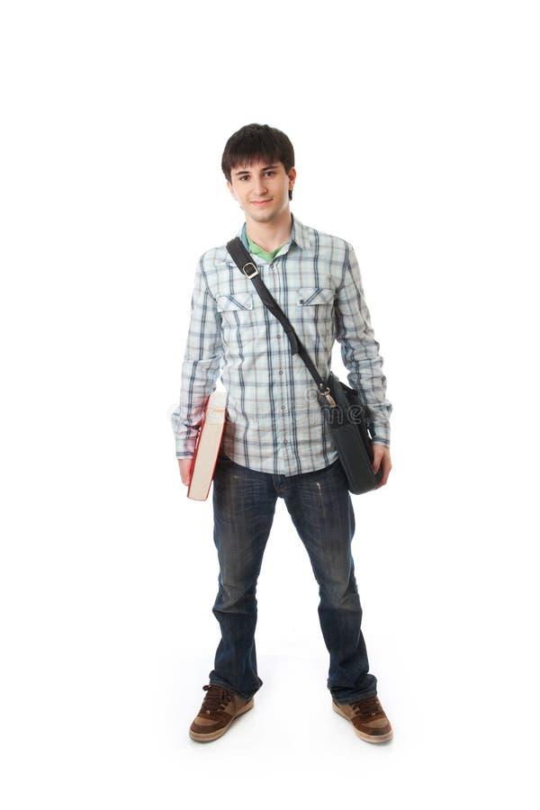 Le jeune étudiant d'isolement sur un blanc photo libre de droits