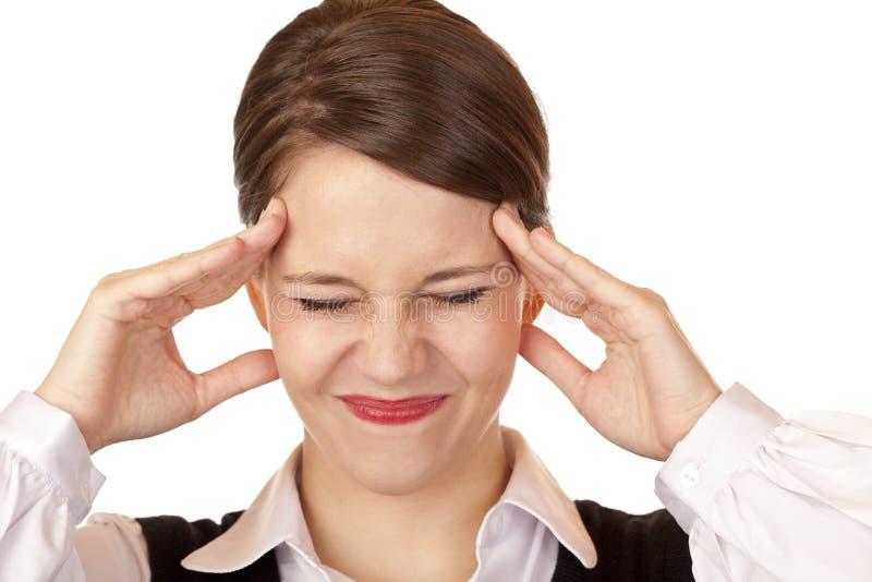 Le jeune femme d'affaires a la migraine intense image stock
