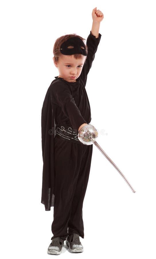 Le jeune garçon a rectifié dans Zorro images libres de droits
