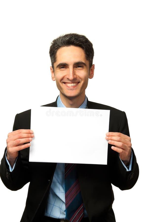Le jeune homme d'affaires affiche la publicité. image libre de droits