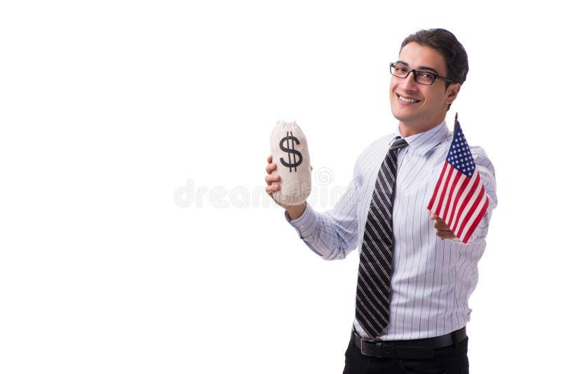 Le jeune homme d'affaires avec le drapeau américain et l'argent renvoient sur le blanc photographie stock libre de droits
