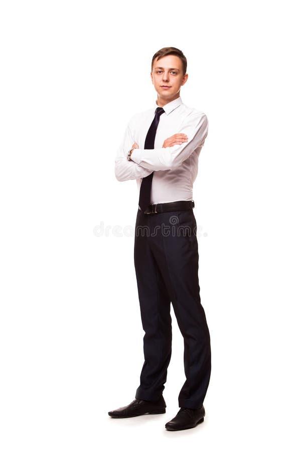 Le jeune homme d'affaires bel tient les mains croisées Portrait d'isolement sur le fond blanc images libres de droits