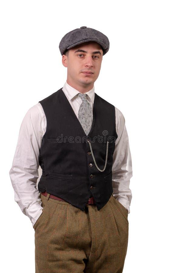 Le jeune homme dans le vintage vêtx avec le chapeau, 1940 dénomment, sur le blanc photo libre de droits