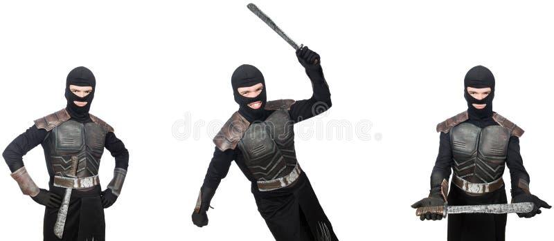 Le jeune homme drôle dans le costume d'armure photographie stock libre de droits